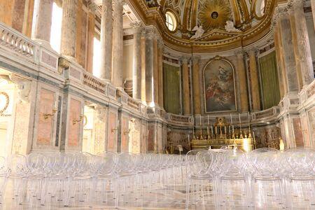 Interior of the chapel inside the palace. Contemporary plexiglass chairs. Redakční