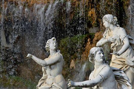 White marble sculptures under water cascade