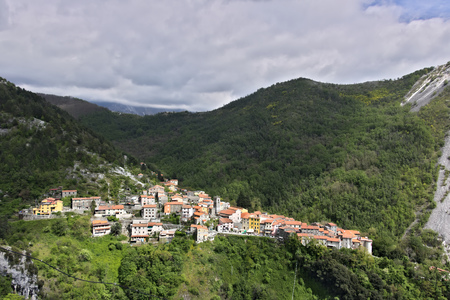 Colonnata, Carrara, Tuscany, Italy.  View of the town of Colonnata, famous for the production of lard.The walls of the houses in stone and white Carrara marble. Woods background. Northern Tuscany.