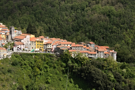 Colonnata, Carrara, Italy.View of the town of Colonnata, famous for the production of lard.The walls of the houses in stone and white Carrara marble. Woods background. Northern Tuscany.