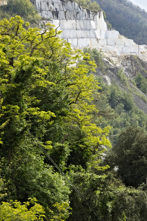 Colonnata, Carrara, Tuscany, Italy. From the village of Colonnata you can enjoy wonderful views of the white Carrara marble quarries. The villagers work in the nearby marble quarries.