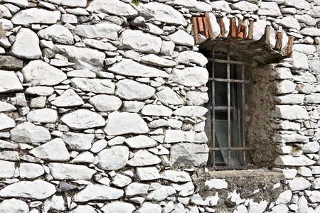 Colonnata, Carrara, Tuscany, Italy. Detail of windows and walls made of white marble extracted from the nearby quarries. Colonnata is famous for the production of tasty lard.