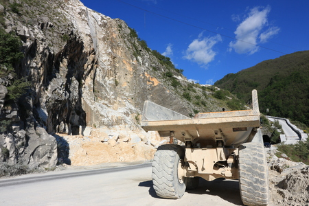 Carrara, Italy. 05/31/2019. A dumper truck used in a Carrara marble quarry. Large yellow dump truck with body.