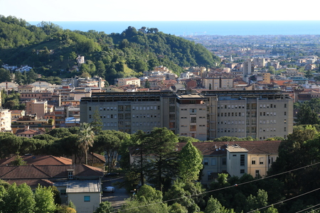 Panoramic view of the city of Carrara, at the foot of the Apuan Alps. In the background the sea.
