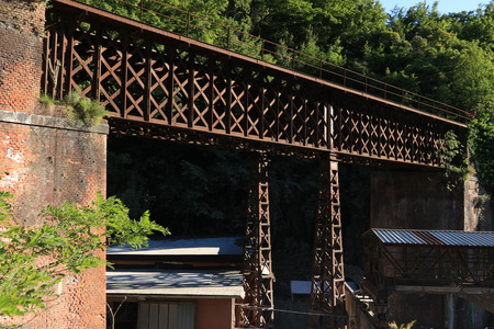 Iron bridge with reticular structure. The bridge was part of the ancient Carrara marble railway.