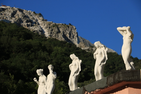 White marble sculptures exhibited in Carrara. Copies of classical sculptures (David, Venere, Eris ...)  in a souvenir shop.