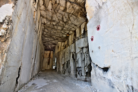 White Carrara marble quarry made in the gallery. The use of diamond tools allows to dig the marble blocks in underground galleries.
