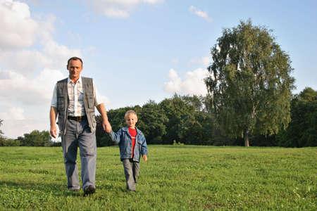 grandfather and boy walking photo