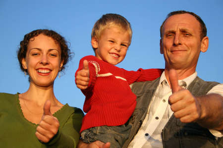 intergenerational: boy, mother and grandfather giving ok