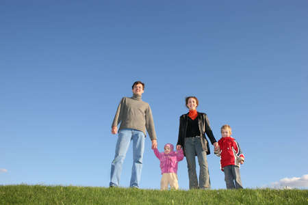 family of four on grass photo