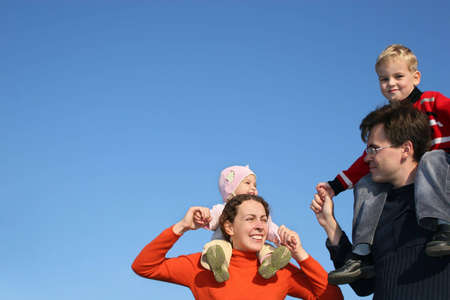 family with children on shoulders Stock Photo