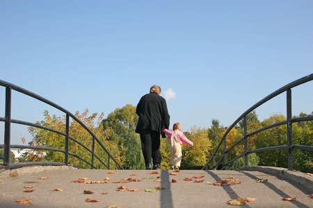 grand kids: behind grandmother and  on autumn bridge