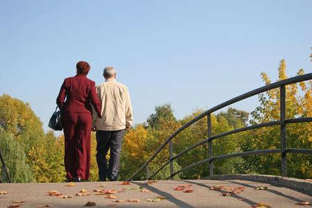 behind couple on autumn bridge Stock Photo