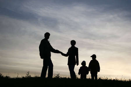 man take woman with two children. silhouette photo