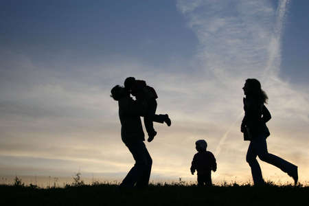 silhouette family of four photo
