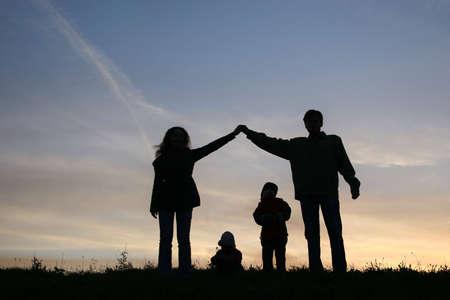 silhouette family house photo