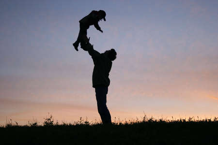 hang body: silhouette father with child