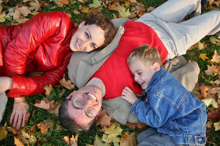 family on autumn leaves