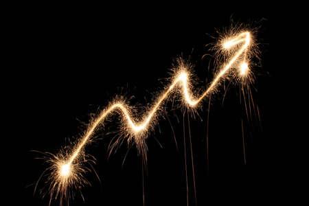 holiday profits: graph arrow sparkler