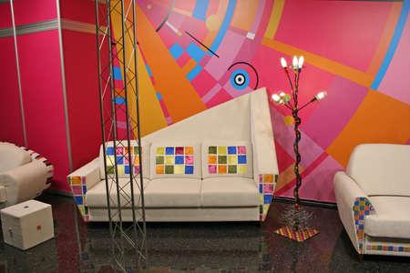 white sofa, color spots Reklamní fotografie