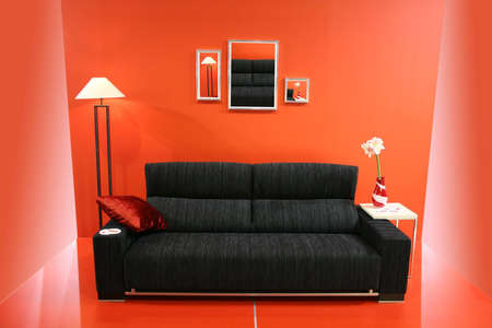 black sofa on red wall Stock Photo - 811390