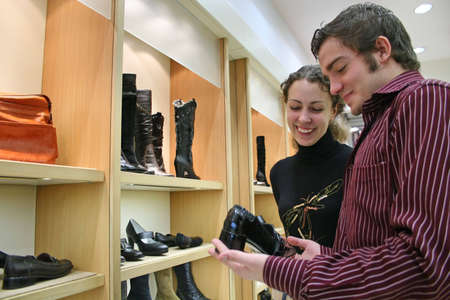 footgear: couple in shoes shop