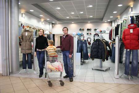 emporium: family in clothes shop Stock Photo