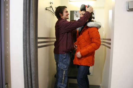 couple in fitting-room photo
