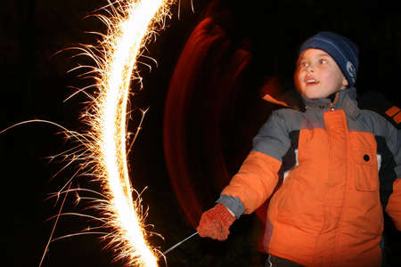 child with moving sparkler Stock Photo
