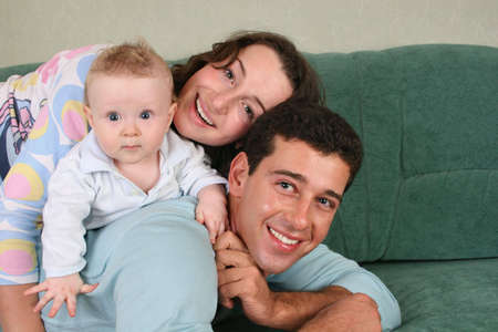 family with baby on sofa 2 Stock Photo - 901524