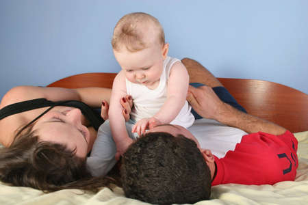 family with baby on bed Stock Photo - 901569