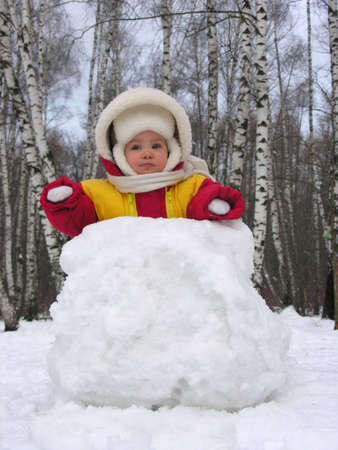 baby with snowball Stock Photo