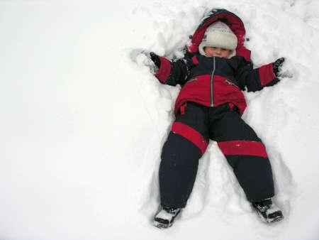 boy fall to snowbank photo