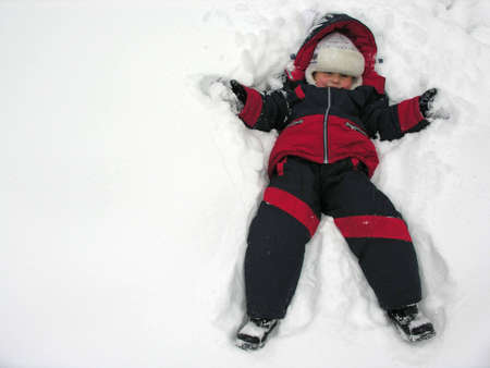 boy fall to snowbank Stock Photo