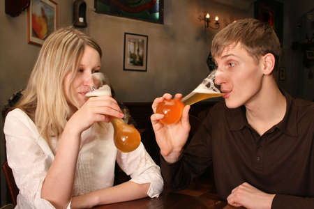 couple with beer in bar photo