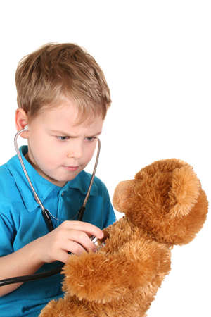 boy with stethoscope and toy photo