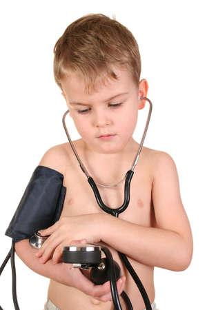 stethoscope boy: child with sphygmomanometer Stock Photo