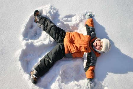winter jacket: boy lies on north pole snow