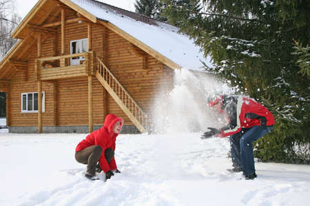 couple winter house throw snow Stock Photo - 906596