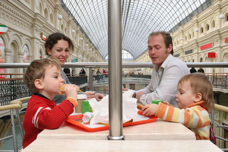 family in cafe in big shop photo