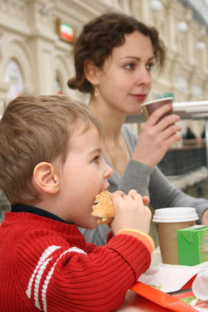 mother with boy in cafe photo