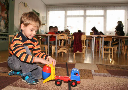 children playing with toys: child in kindergarten 2