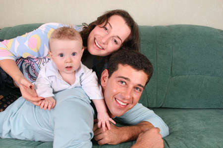 family with baby on sofa 3 Stock Photo - 915000