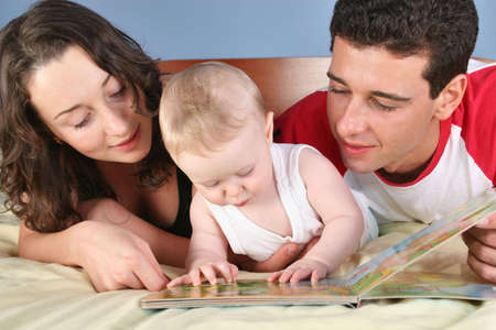 family with baby read book 2 photo