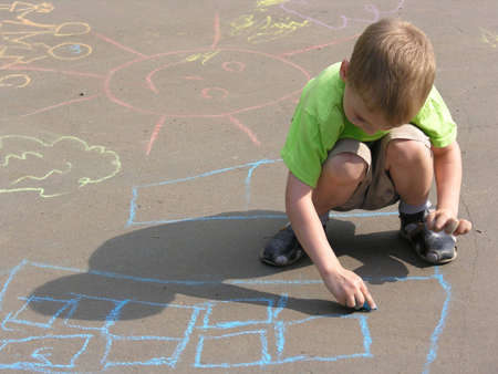 child drawing on asphalt photo