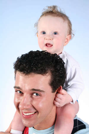 baby on fathers shoulders 2 Stock Photo