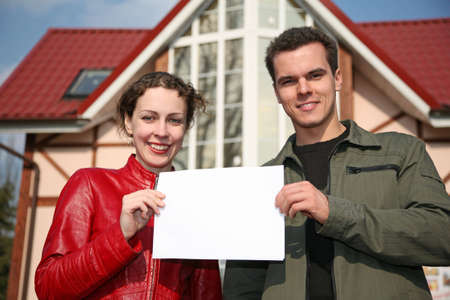 couple with card and house Stock Photo - 2192178