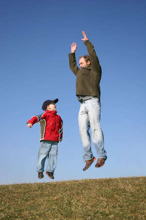 full strenght: jumping father with son Stock Photo