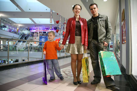 family with boy in shop