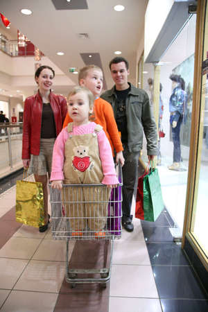 shopping carriage: family with children in shop